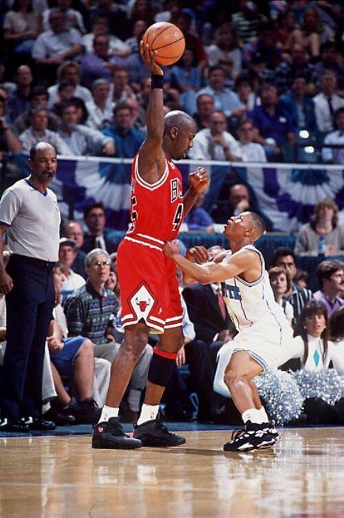 Michael Jordan Chicago Bulls vs.Mugsy Bogues Charlotte Hornets That's called facing a giant