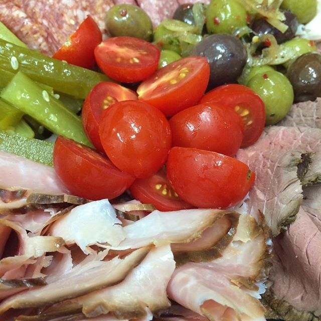 A great party plate full of cured meats, olives, gherkins, cherry tomatoes and other tasty delicacies. YUM! 🍅#2delicious4words #sydney #mezzeplate
