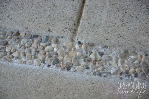 Excellent and effective way to fill in gaps on a concrete patio.  Use pea gravel.