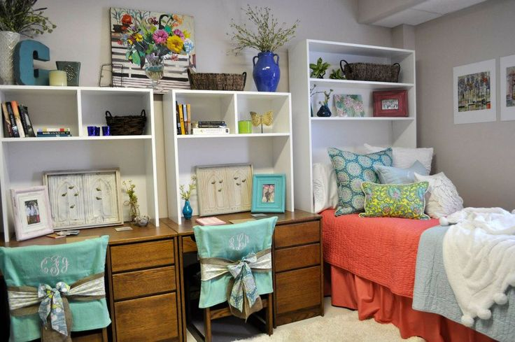 Love the use of this shelving unit, in place of a headboard, to create additional storage space... along with matching shelves/hutches over the desks.