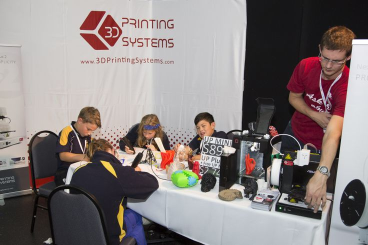 Wairakei School students demonstrating the 3D Pen on 3D Printing Systems' stand.