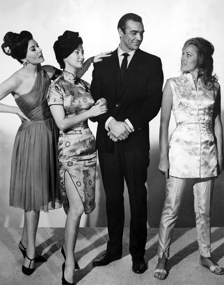 Sean Connery, with Eunice Gayson, Zena Marshall, and Ursula Andress, in a publicity photo for DR. NO (1962)
