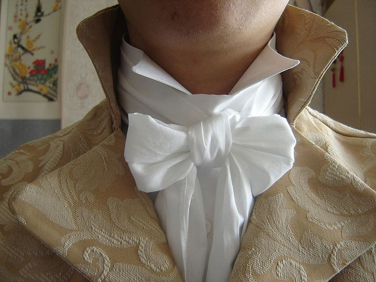 The best (and hardest-to-tie) Regency cravat knot, worn with a Grafton collar. I really, really wish the model had shaved properly before they took this picture.