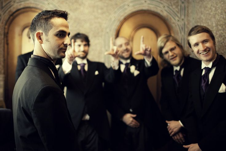 The #groomsmen reminding their friends what hand was his left | Tim and Madie Photography.