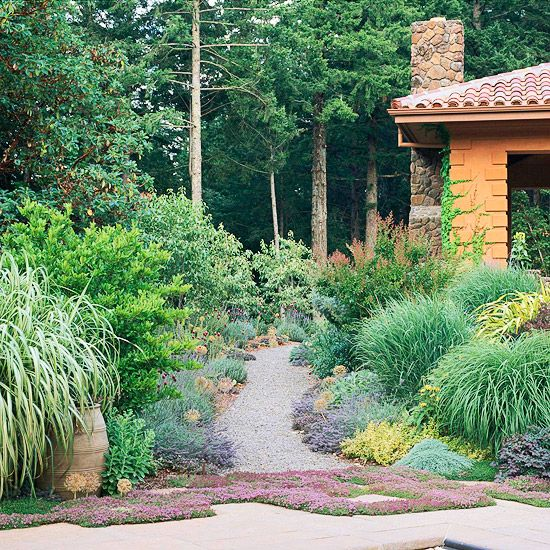 Good Grasses - Make pathways from a porous material, such as gravel, instead of non-permeable concrete so soil can absorb some water before it runs off. Ornamental grasses offer color and structure in this drought-resistant garden. Purple catmint and allium edge the gravel path in this flowerbed.