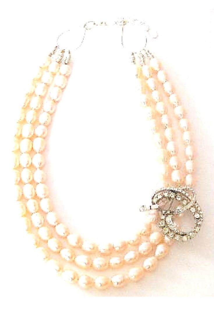 Pink freshwater pearls & Vintage Brooch necklace.  One-of-a-kind statement necklace handmade with pink freshwater pearls paired with vintage brooch $250,00. #statementnecklaces#necklaces#freshwaterpearl#handmadenecklace