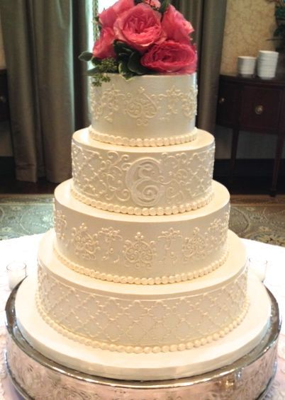 Beautiful wedding cake. I'd change the color of the flowers on top because I prefer a monochromatic look  with lots of texture.