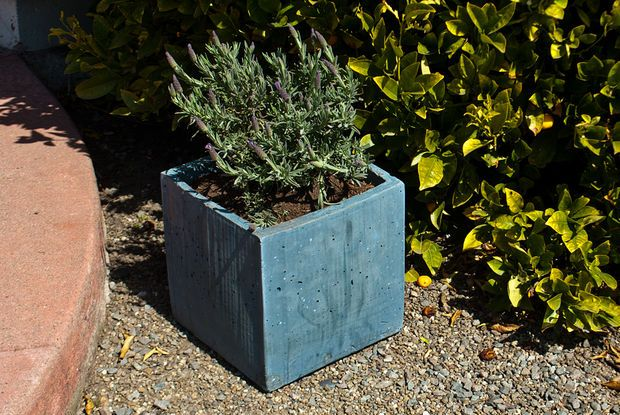 Concrete planter box Instructables - looks easy and inexpensive.  I want to make these and then do mosaic tiles on top.
