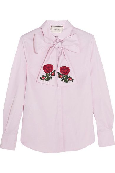 """These are the clothes to give you the freedom to choose who you are,"" says Alessandro Michele of Gucci's bold new chapter. This lilac cotton blouse has been made in Italy with a retro-inspired pussy-bow neckline intricately embroidered with red blooms. Let it peek out from under a sharply tailored blazer – as seen at the Pre-Fall '16 presentation."