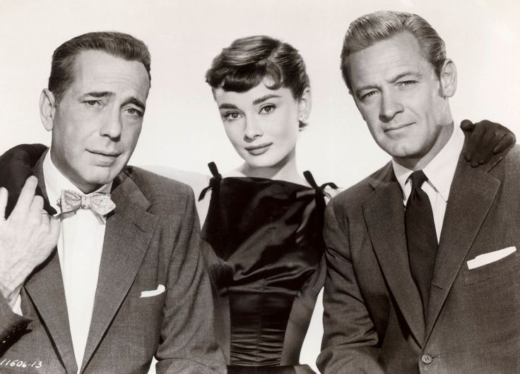Hepburn, Humphrey Bogart and William Holden on the set of 'Sabrina.' Hepburn and Holden reportedly engaged in a brief but passionate affair during the filming though Holden was married at the time. (Photo:  Sunset Boulevard/Corbis)