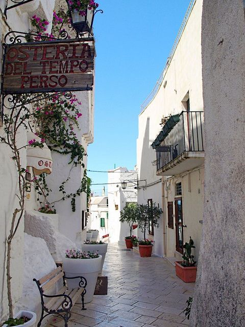.   Puglia, Italy Picture you strolling down this narrow street.  What waits at the end?  Quaint restaurants, maybe a street carnival or interesting shops.  Adventure waits.