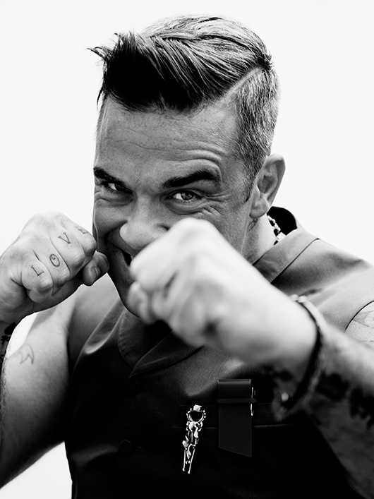 Robbie Williams. So uncool and so very cool all at once. How does he do that? Love him.