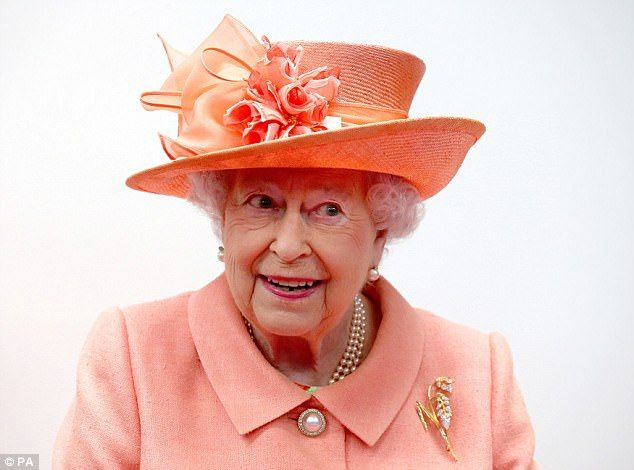 One is very amused! The monarch also presented with a silk scarf Highland Spring tartan af...