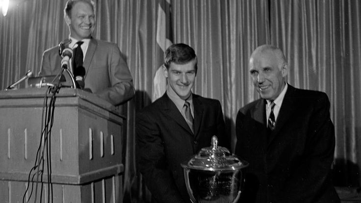 Bobby Orr, recipient of the Norris Trophy, with Clarence Campbell and Bobby Hull.