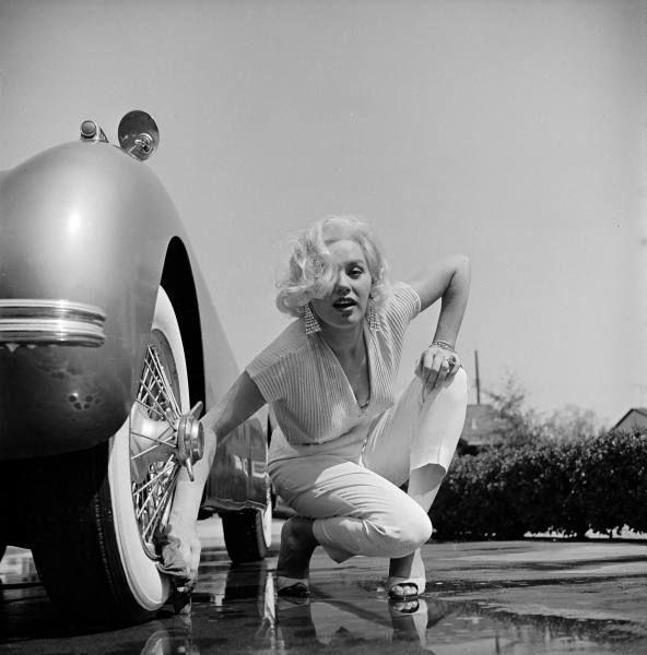 Mamie van Doren washing the whitewalls on her Jaguar