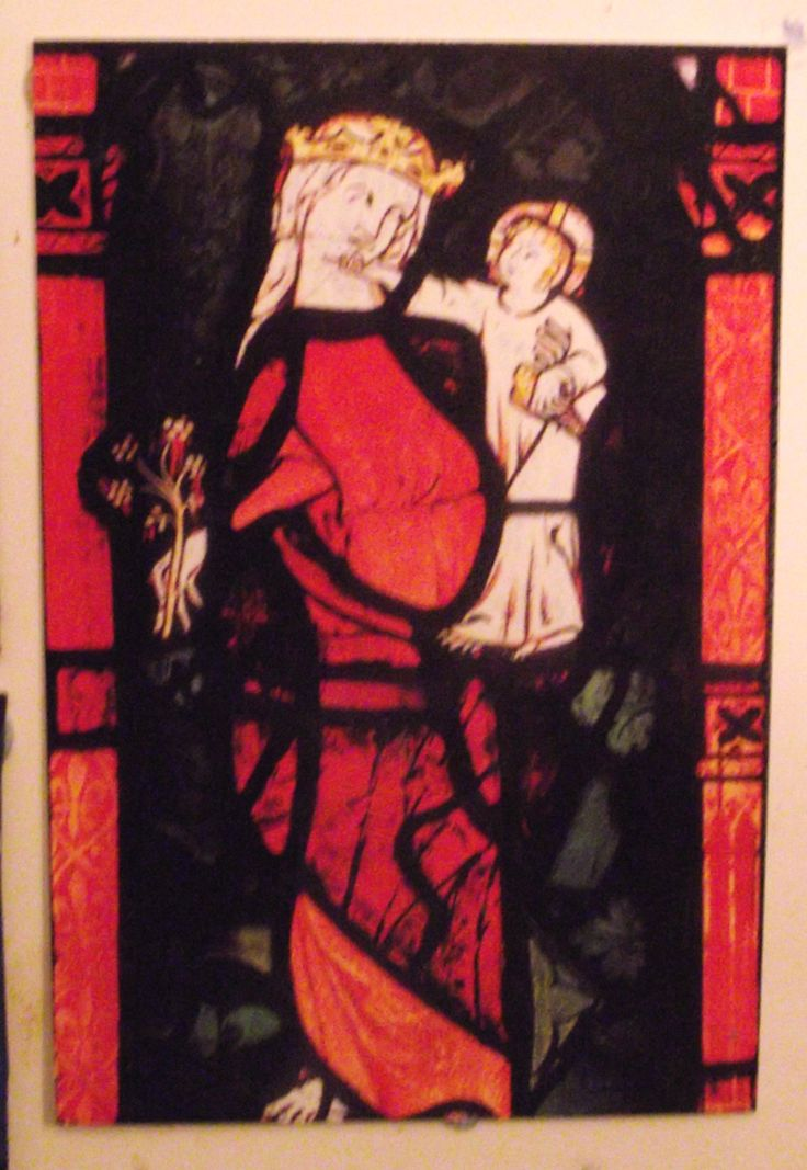 St Michael's Church, Eaton Bishop in Herefordshire has the most beautiful 14th century stained glass to be seen anywhere; and this Virgin and Child is the best in the church. The figures gaze with love at each other, she with a loving smile while Jesus reaches to caress his mother's chin. He holds a goldfinch, symbolising his Passion; she bears a flowering rod, indicating his human genealogy.  The smiling figure in mediaeval art is one of the great advances in civilization.  [Philip Weaver]