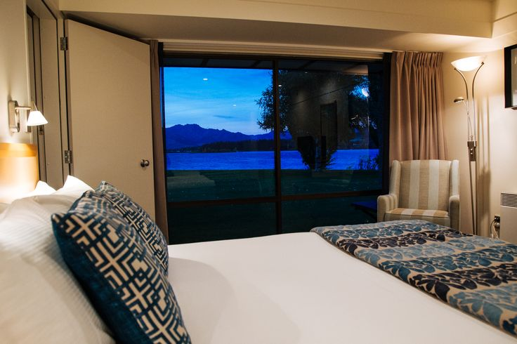 We've been refurbishing our rooms.  Here is our fresh new look, complete with blue accent.  (The lake views haven't changed though!)