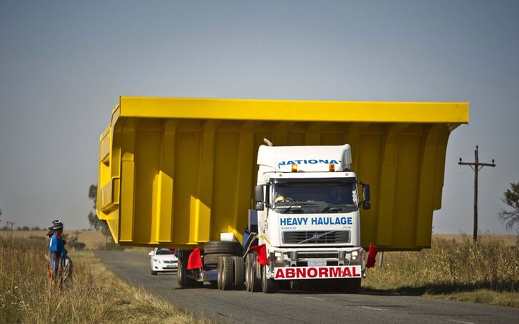 South Africa's largest road freight truck travels on a road near Johannesburg. The wide load lorry's freight carrier is 10.1 metres wide and 5.4 metres high. The vehicle in total is 13 metres long and weighs 85 tons.  Picture: Gallo Images / Rex Features