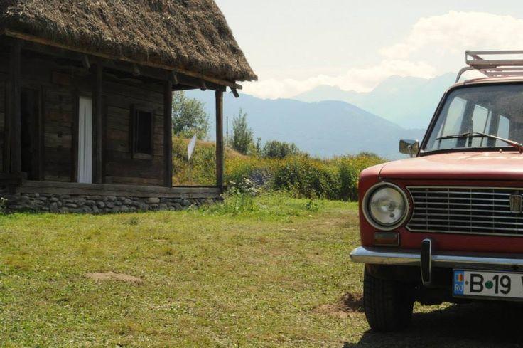 Lada 1200 and a traditioanal Romanian house