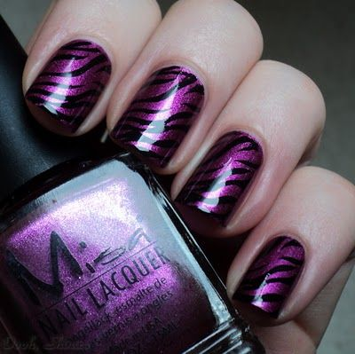 Love!!  I'm wild over this purple zebra print nail art.