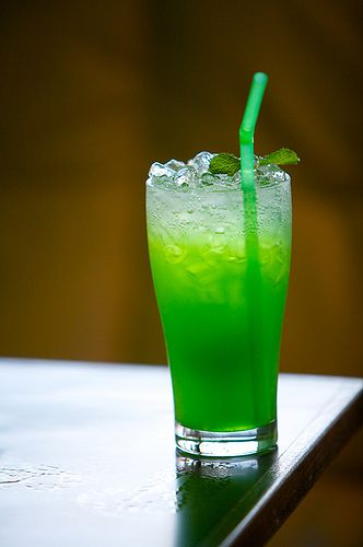 Lucky Leprechaun Cocktail        * 1 oz Midori Melon Liqueur      * 1 oz Mailbu Rum      * 6 oz Pineapple Juice      * Mint sprigs for garnish.