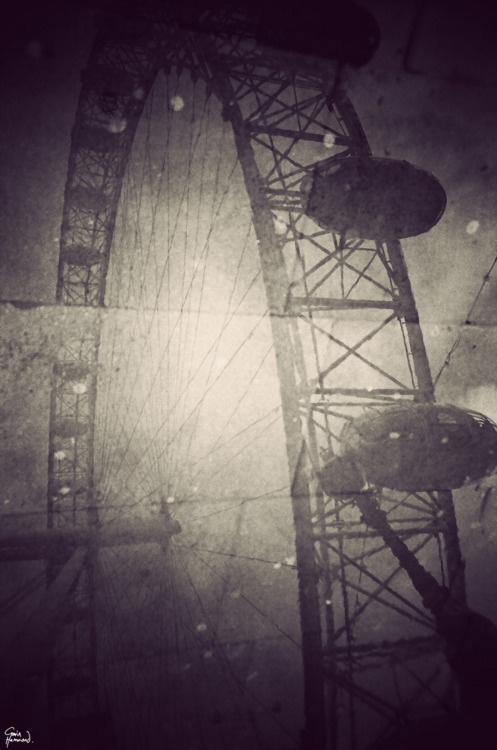 London - Gavin Hammond's London reflected in puddles - I love this one of the London Eye