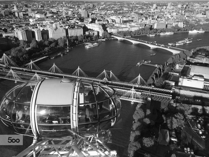 The view of London Eye from above in black and white.