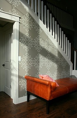 I like the idea of using wallpaper on a staircase wall.  Sometimes there isn't a lot you can do with this space, style-wise.