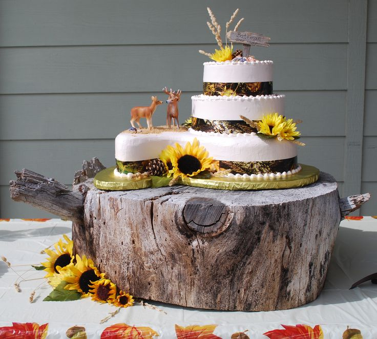 Camo Wedding Cake With Sunflowers And Rustic Wood Slab Cake Stand ...  Toptierweddngcakes.
