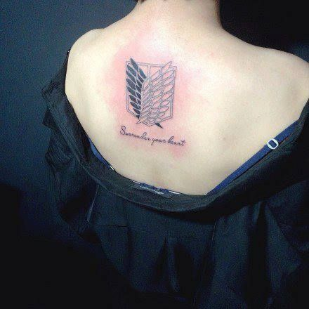 Attack on titan tattoo. ((This is the design I really like, but maybe without the quote.))