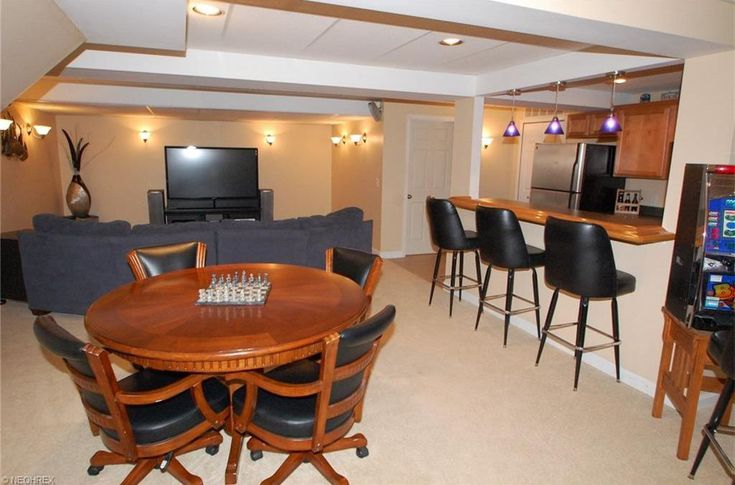 Contemporary Game Room with Wall sconce, High ceiling, Carpet, Pendant Light, Built-in bookshelf
