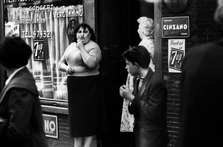 "1958. Prostitute ""Apache Alie"" in front of café De Zeevaart at the Oudezijds Achterburgwal in Amsterdam. Photo: Ed van der Elsken #amsterdam #1958 #OudezijdsAchterburgwal"
