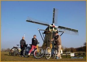 Through the Dutch polder on a bike to a greenhouse