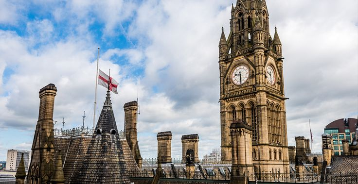 Image of Manchester Town Hall with flags at half mast.