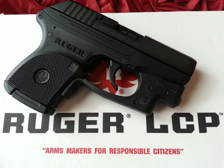 My new Black Beauty! It fits into the palm of my small hand! Ruger LCP .380 Caliber Auto with Crimson Trace Laser Guard-431