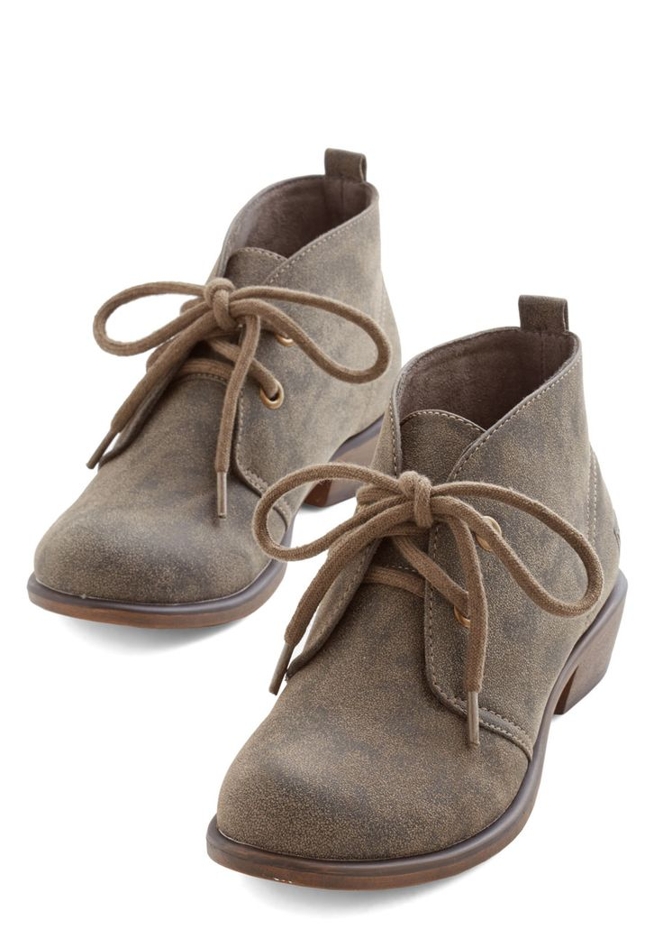 Tour Date Bootie in Pavement. You travel the world to spread your music, and tonight you lace up these olive-brown booties before sound check. #grey #modcloth