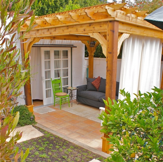 love, obviously, the pergola, but also the curtains...great for some privacy on the front porch.