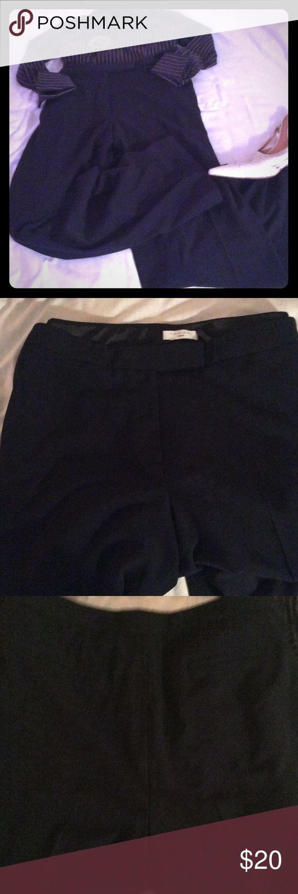 Tahari Woman Navy Trousers NWT Tahari Woman Navy Blue Trousers, 63% Polyester, 32% Viscose, 5%Rayon, 36 inch Inseam, Nice Pants for Plus Size Woman. The Inseam is 36 Inches, maybe for a Tall Plus Woman. The Plus is these Pants are very nice! Tahari Woman Pants Trousers