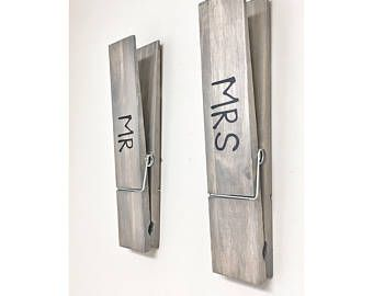 What a unique and fun way to hang your towels in your bathroom or laundry room. Can also be a fun way to display photos, kids drawings, or notes in your home, nursery or office with a large rustic decorative walnut stained clothespin. Customize your clothespin with your name or childs name. This listing is for ONE huge jumbo sized clothespin - is hand stained in a dark walnut and varnished. This large 12 inch clothespin can be hung on the wall or even set upright on a shelf, mantel or on…