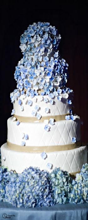 Hydrangea wedding cake. Maybe sunflowers at the bottom?