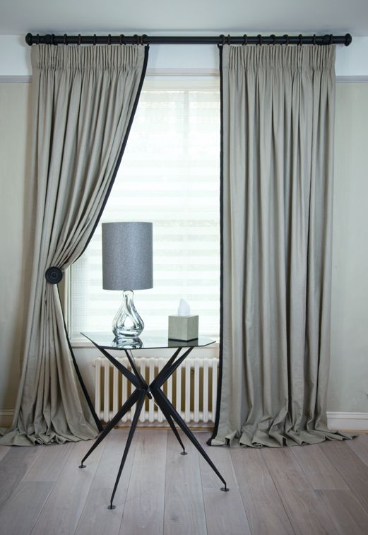 Pencil pleat heading light gray curtains. Love!