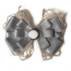 I have a reflector bow almost like this attached to an ivory winter coat.
