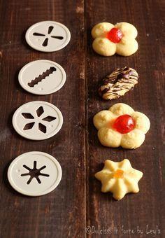 Frolla montata per sparabiscotti:--- NGREDIENTI (circa 30-40 pezzi) ●200 g. burro morbido ●80 g. di zucchero a velo ●1 bustina di vanillina ●1 puntina di scorza di limone ●1 uovo ●300 g. di farina ●1 cucchiaio di Rum ---Per decorare: mandorle, granella di nocciole, pistacchi sminuzzati, frutta candita, ciliegie candite…