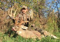 Cody Miller with his Big City buck shot during an early November bowhunt.