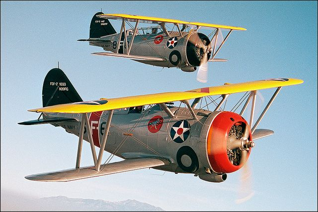 Two Grumman F3F-2 biplanes with retractable landing gear