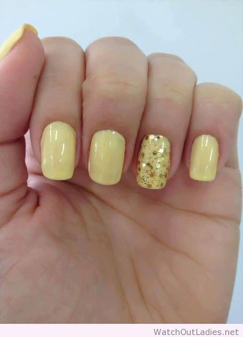 Light yellow nail polish and glitter