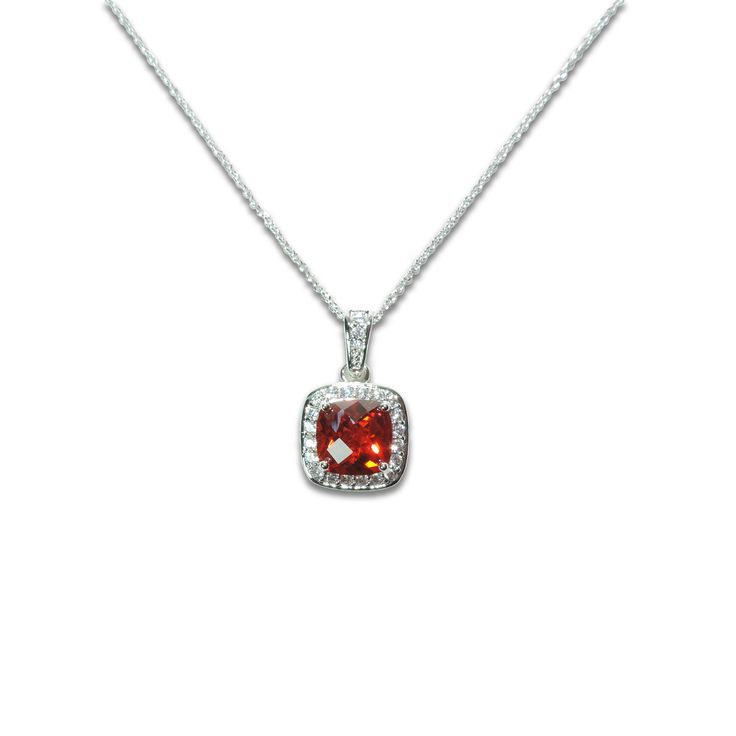 Stunning Cushion cut Garnet colored CZ stone encircled by a dazzling set for clear CZ stones (finished in Rhodium)