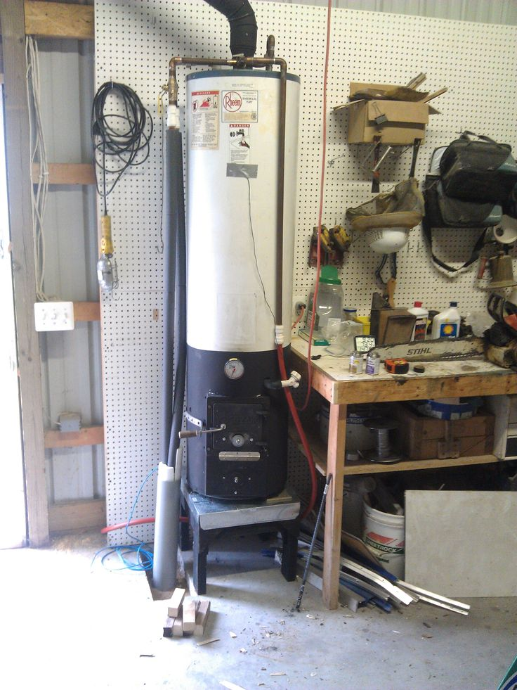 This is the details of my wood-fired water heater, converted from a natural gas water heater.  Sounds dangerous doesn't it? The finished product of this project pictured above, of course.  You can see that it's a plain old Rheem (the gas burner and valve...