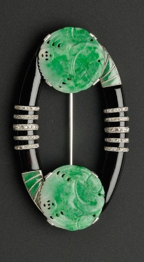 Boucheron - An Art Deco Jadeite, Onyx, and Diamond Brooch, Paris, circa 1923. Composed of two pierced and carved jadeite disks joined by arched onyx plaques highlighted by rose-cut diamond bands, accented by buff-top jadeites, platinum mount, signed Boucheron Paris, numbered. According to Boucheron's records, this brooch was made in 1923 and sold at Boucheron London in 1928. #DiamondBrooches