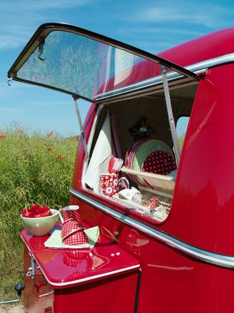 Exterior of a cute red camper from The Painted House blog.  Love the dishes, too.